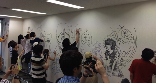 shogakukan manga demolish building comic artists draw walls