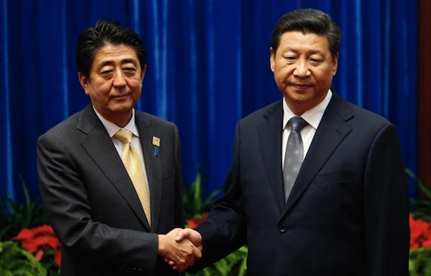 shinzo abe xi jinping handshake apec summit